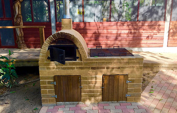 Wood-fired Fogón for traditional fare and great tasting pizza